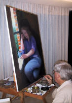 Photo of Gene Gould signing one of his paintings